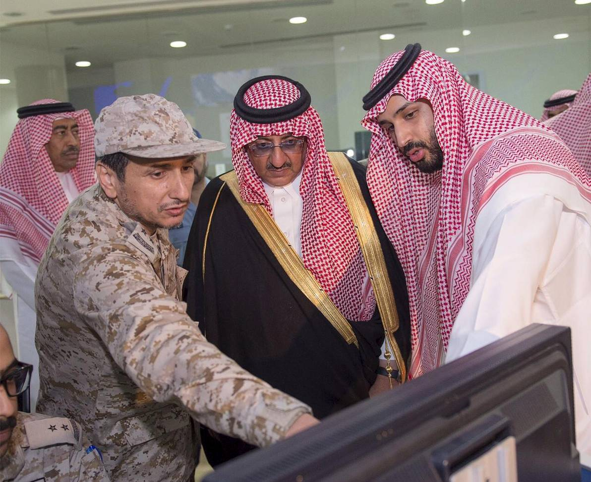 Saudi Arabia's Crown Prince, Muhammad bin Nayef, and Defence Minister Mohammad bin Salman pour over military maps