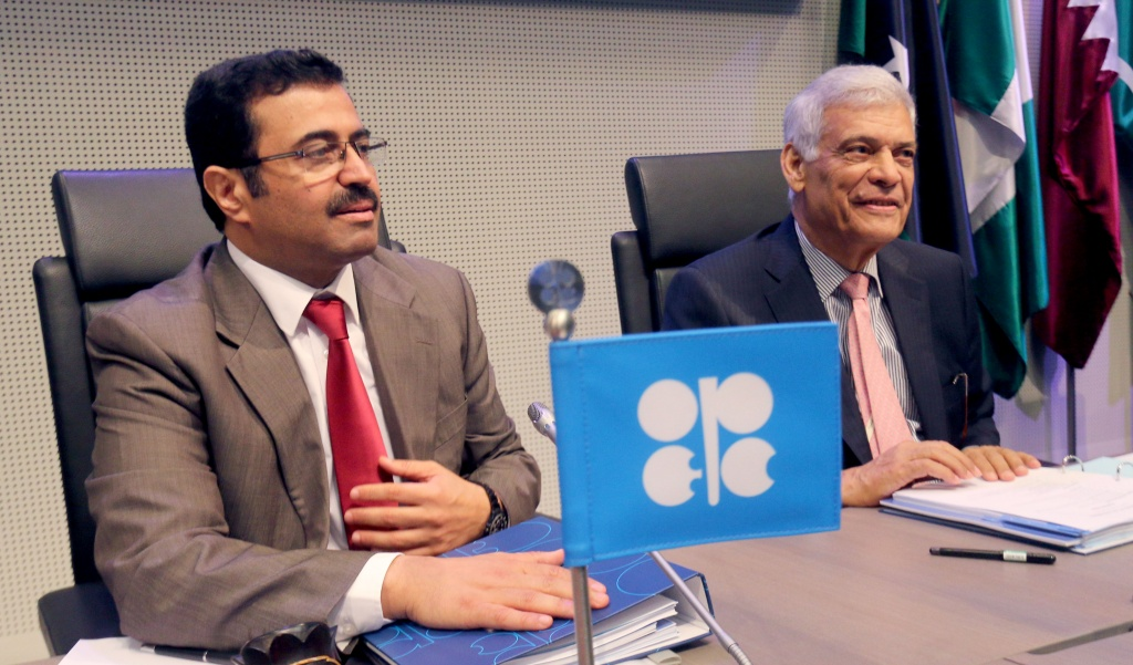 Mohammed Bin Saleh Al-Sada, Minister of Energy and Industry of Qatar and President of the OPEC Conference, and OPEC's Secretary General Abdalla Salem El-Badri, from Libya, from left, wait for the start of a meeting of the Organization of the Petroleum Exporting Countries, OPEC, at their headquarters in Vienna, Austria, Friday, June 5, 2015. (AP Photo/Ronald Zak)