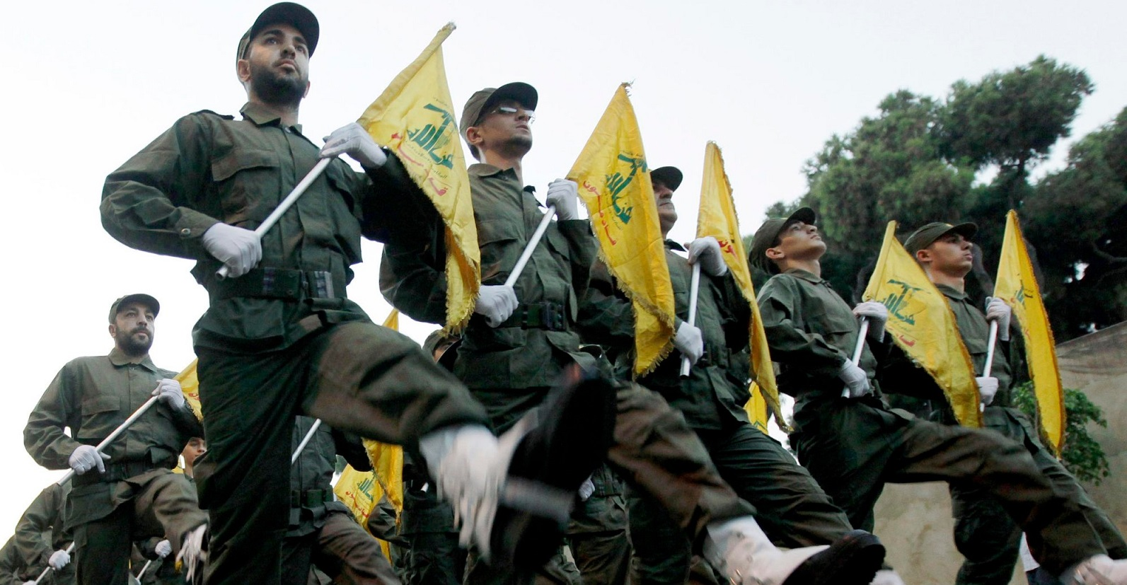 Hezbollah fighters marching in Lebanon.