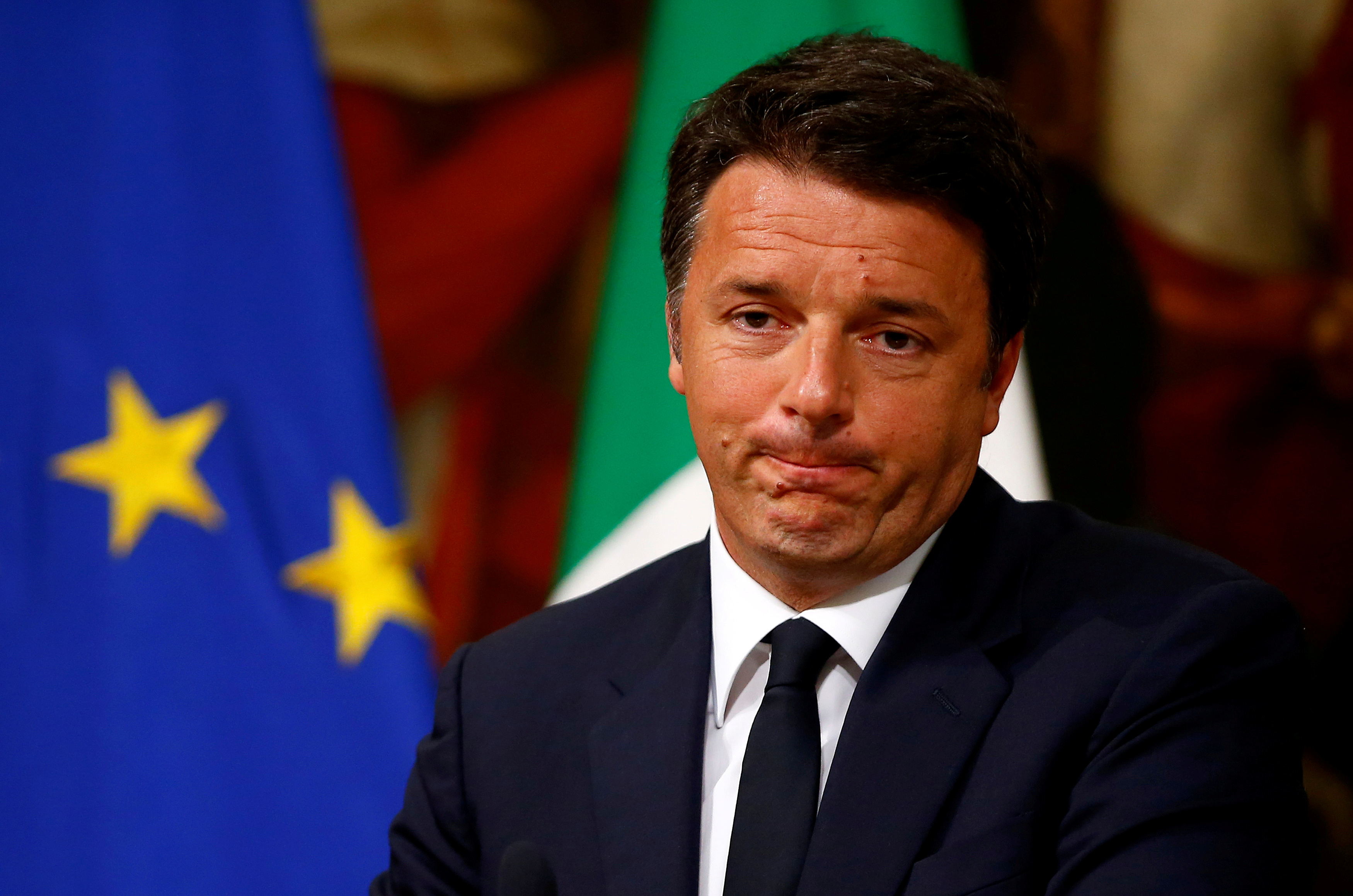 Italy Prime Minister Matteo Renzi makes a face as he talks during a news conference at Chigi Palace in Rome, Italy June 20, 2016. REUTERS/Tony Gentile/File Photo - RTSPNCM