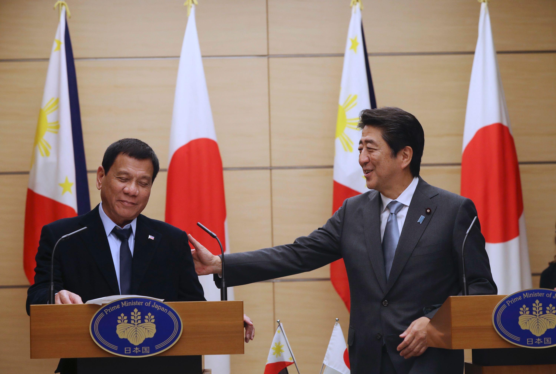 Photo: AFP/AP/Eugene Hoshiko