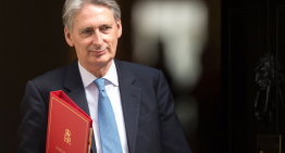 UK budget: less spending, more taxing