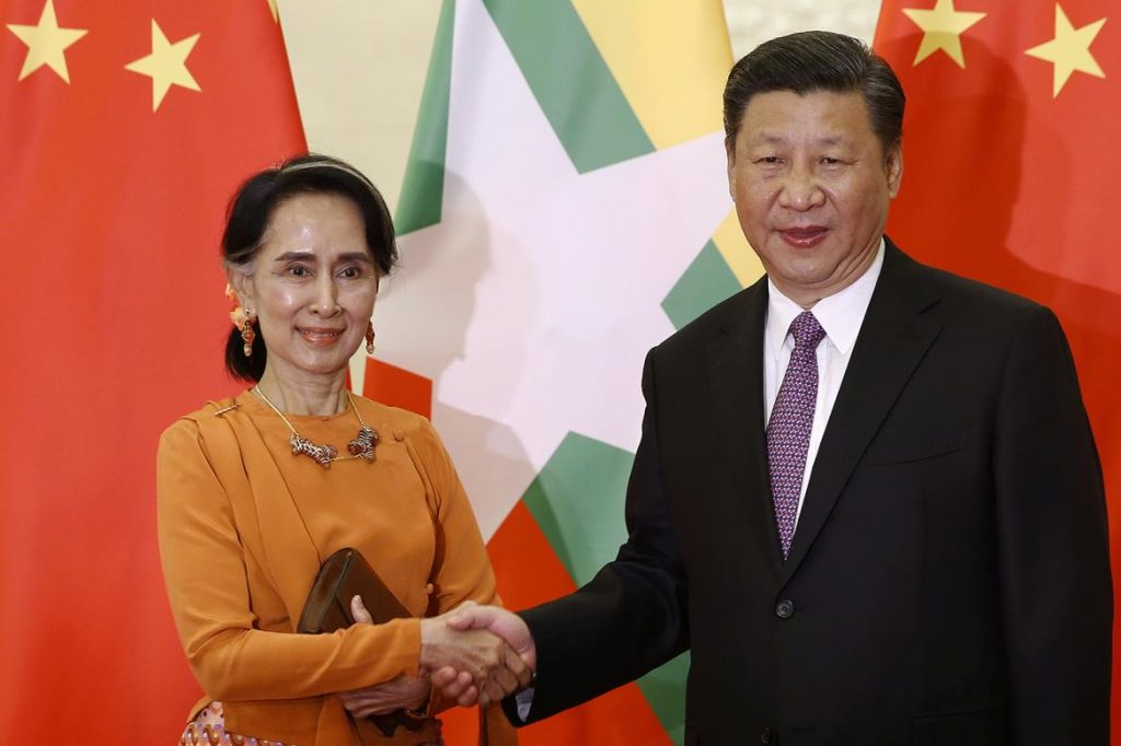 Daw Aung San Suu Kyi shakes hands with Chinese President Xi Jinping during a meeting in Beijing on May 16.
