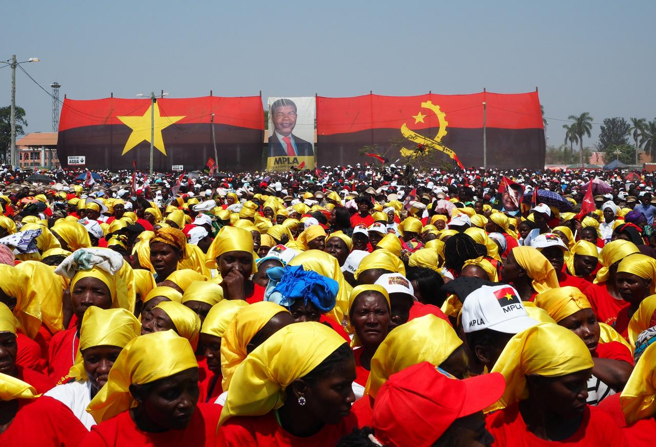Supporters listen as Joao Lourenco, presidential candidate for the ruling MPLA party, speaks at an election rally in Malanje, Angola