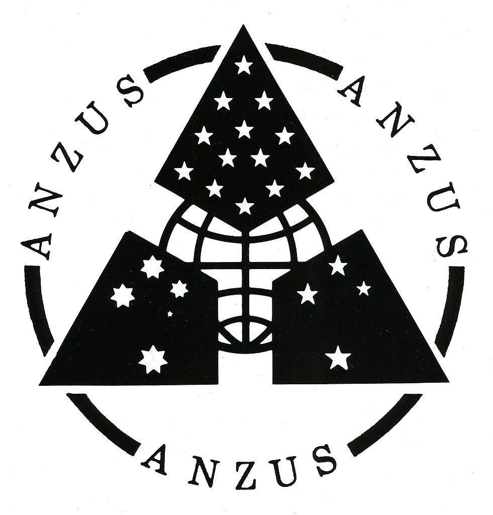 On September 1 1951 the ANZUS military alliance between New Zealand, Australia and the United States was formed. The treaty bound the signatories to recognise that an armed attack in the Pacific area on any of them would endanger the peace and safety of the others. It stated 'The Parties will consult together whenever in the opinion of any of them the territorial integrity, political independence or security of any of the Parties is threatened in the Pacific'. The three nations also pledged to maintain and develop individual and collective capabilities to resist attack. New Zealand was suspended from ANZUS in 1986 as it initiated a nuclear-free zone in its territorial waters; in late 2012 the United States lifted a ban on visits by New Zealand warships leading to a thawing in tensions. New Zealand maintains a nuclear-free zone as part of its foreign policy . The treaty no longer applies between the United States and New Zealand, but is still in force between either country and Australia, separately. Shown here is the logo for ANZUS.