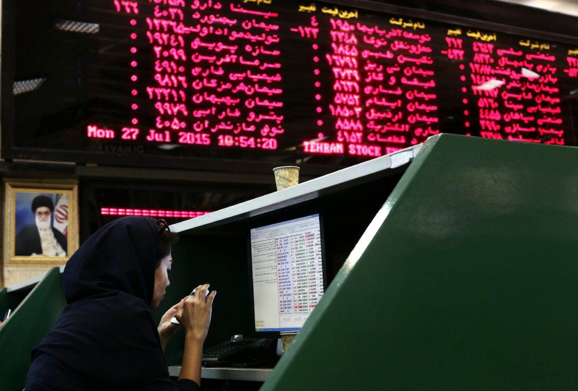 Traders watch as Iran's stock exchange plummets