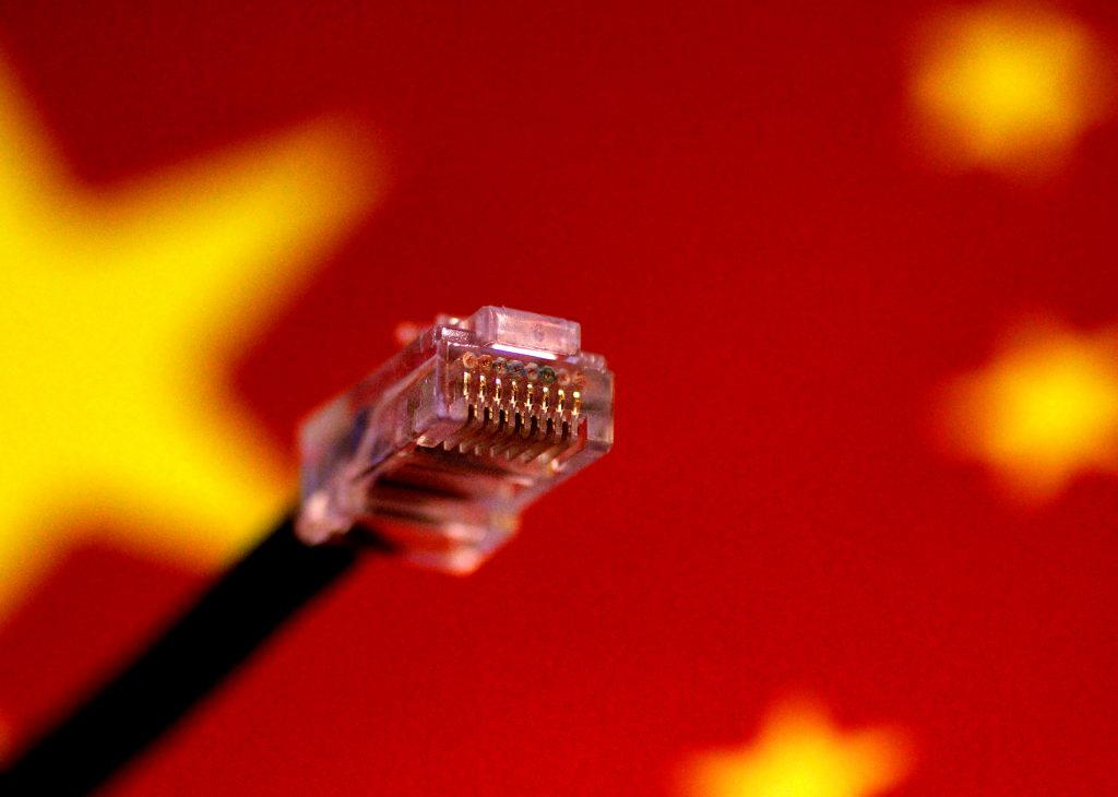 Illustration photo of a computer network cable above a Chinese flag