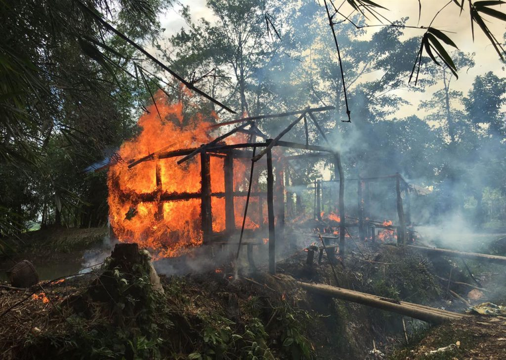 Houses are on fire in Gawdu Zara village, northern Rakhine state, Myanmar, Thursday, Sept. 7, 2017. Journalists saw new fires burning Thursday in the Myanmar village that had been abandoned by Rohingya Muslims, and where pages from the Quran were seen ripped and left on the ground.