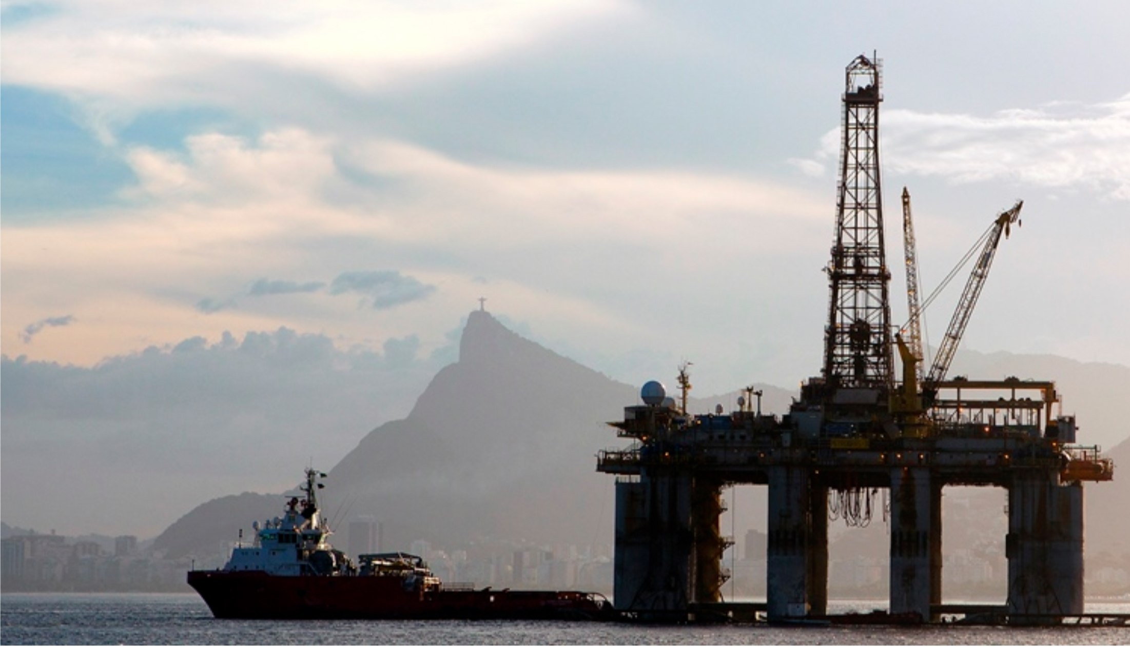 An oil rig floats past Christ the Redeemer in Brazil