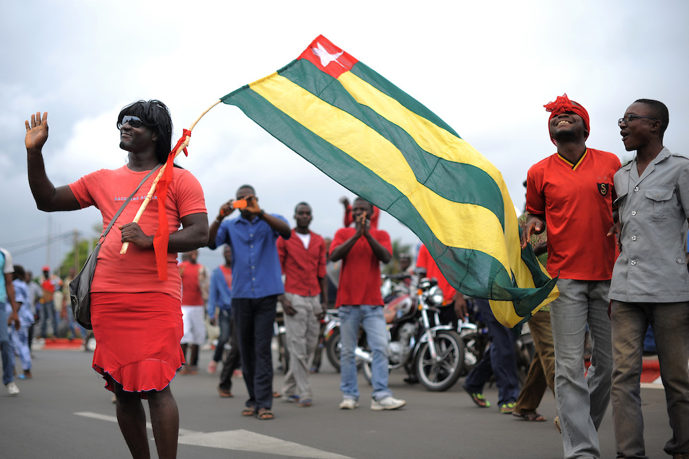 Demonstrators in Togo wave the national flag