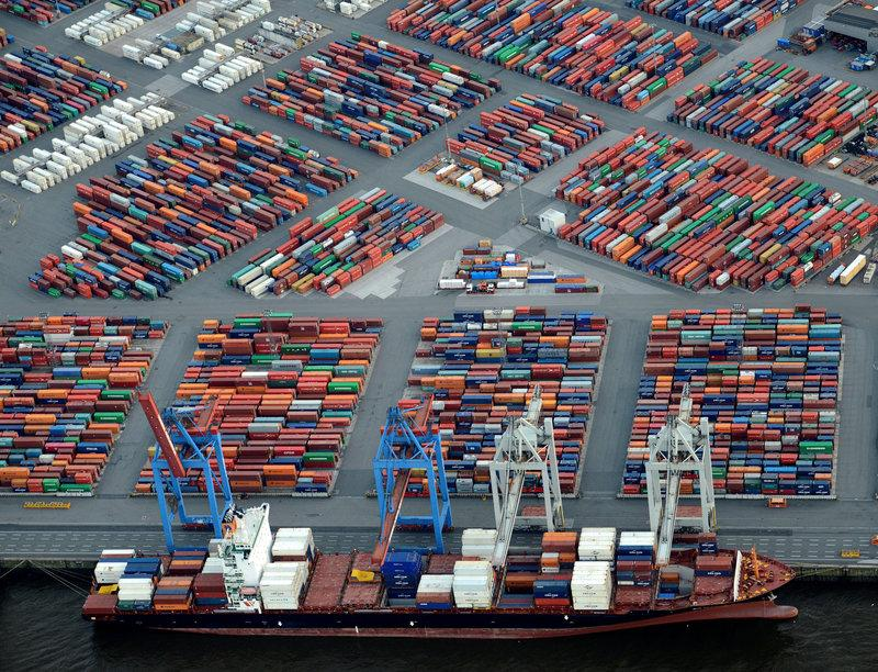 FILE PHOTO: A container ship is loaded at a terminal in the harbour of Hamburg