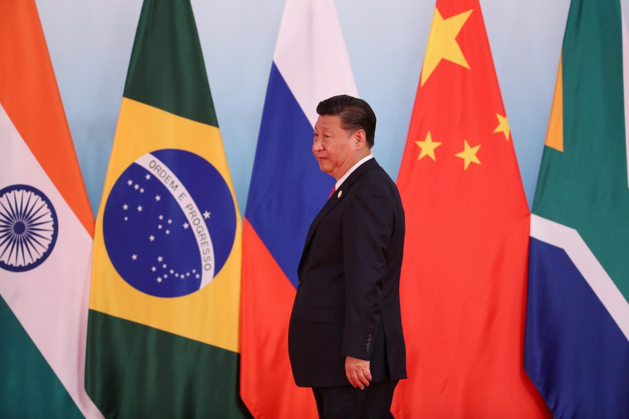 Chinese President Xi Jinping arrives for a group photo during the BRICS Summit in Xiamen