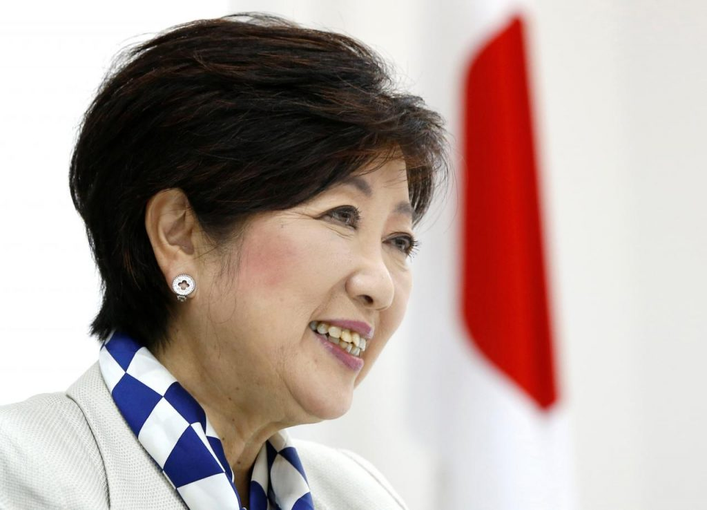 Tokyo Governor Yuriko Koike, head of Japan's Party of Hope, smiles next to a Japanese national flag during an interview with Reuters in Tokyo, Japan October 6, 2017.
