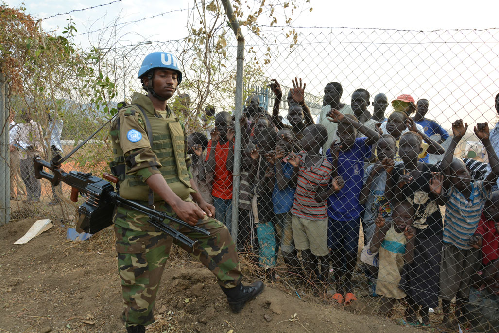 A UN peacekeeper stands guard in South Sudan
