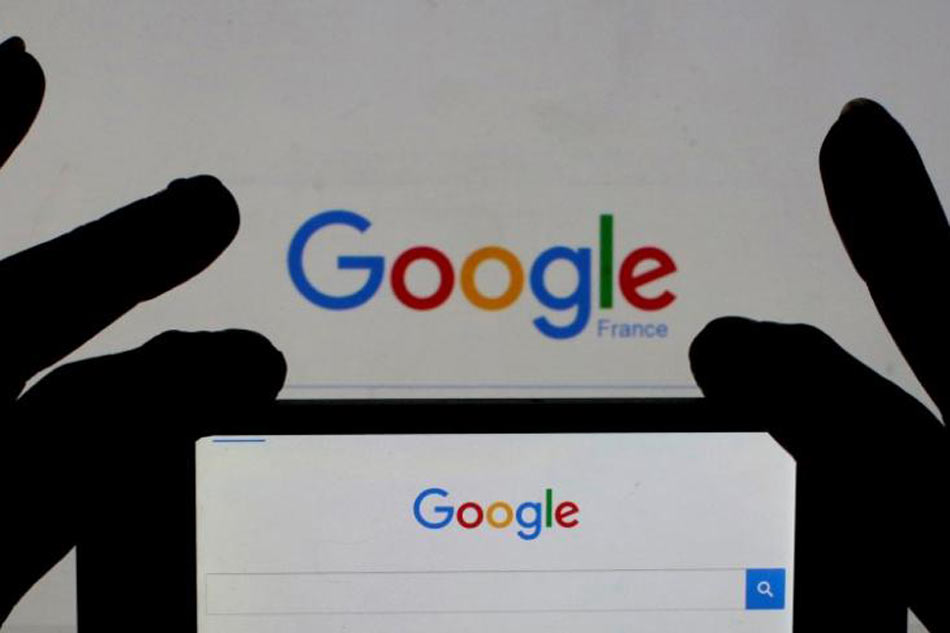 A phone taking a photo of a Google logo