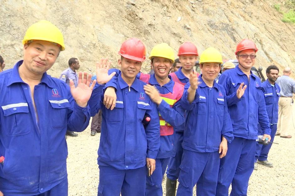 Chinese workers at the China Development Bank-funded Edevu Hydro Project site.