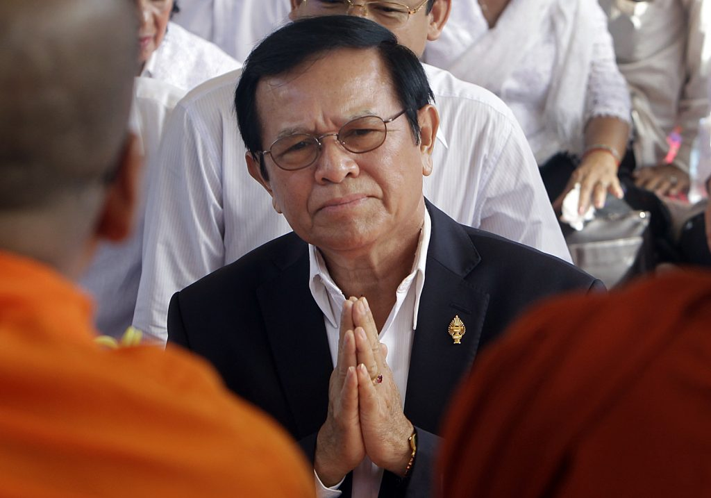 In this Thursday, March 30, 2017, file photo, opposition leader of the Cambodia National Rescue Party Kem Sokha prays during a Buddhist ceremony to mark the 20th anniversary of the attack on anti-government protesters in 1997, in Phnom Penh, Cambodia. Police have arrested the Kem in a surprise raid on his home early Sunday, Sept. 3, 2017. The government issued a statement accusing Kem Sokha of treason, saying he conspired with foreign powers against Cambodia.