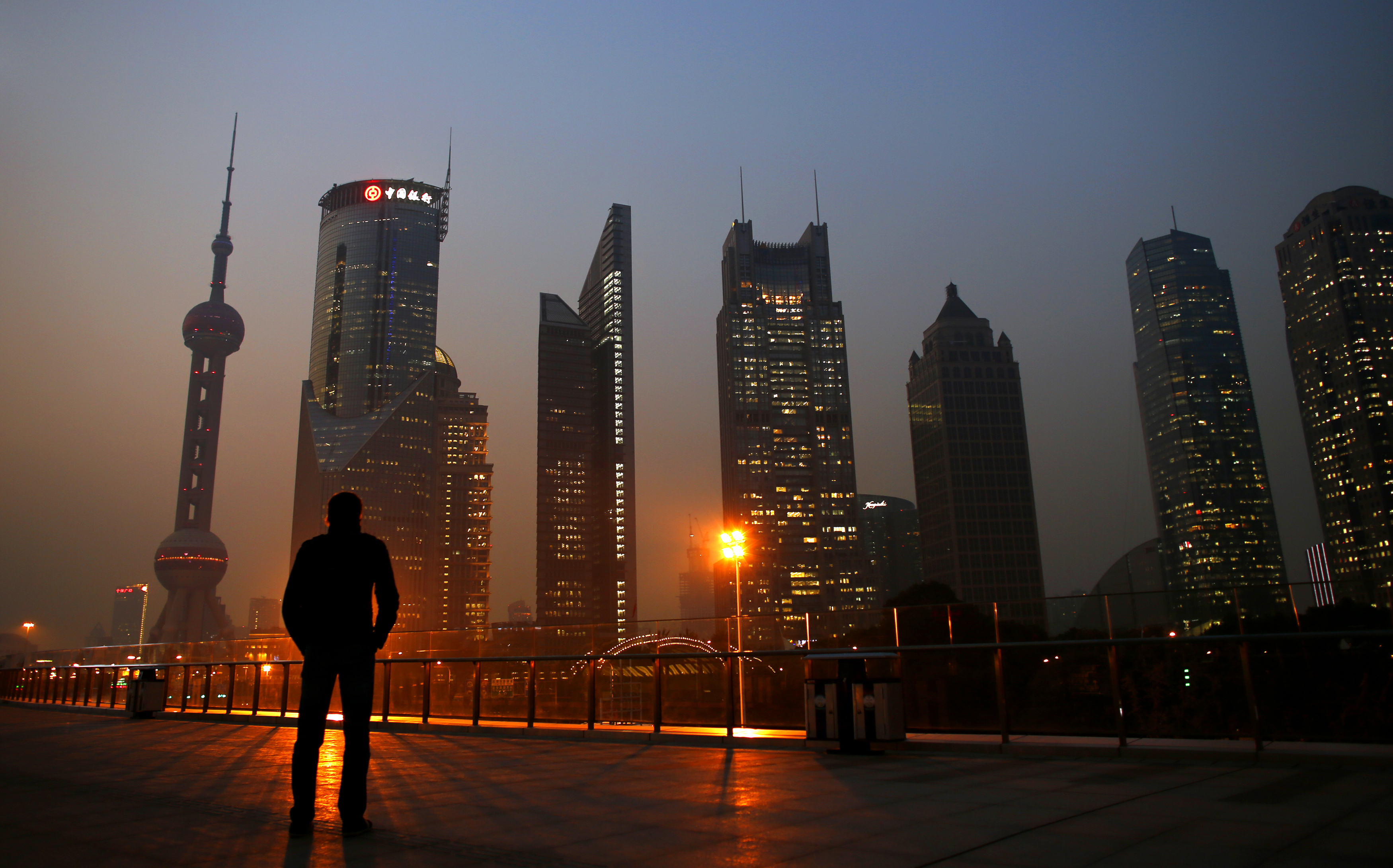 China's fixed-asset investment growth eases further