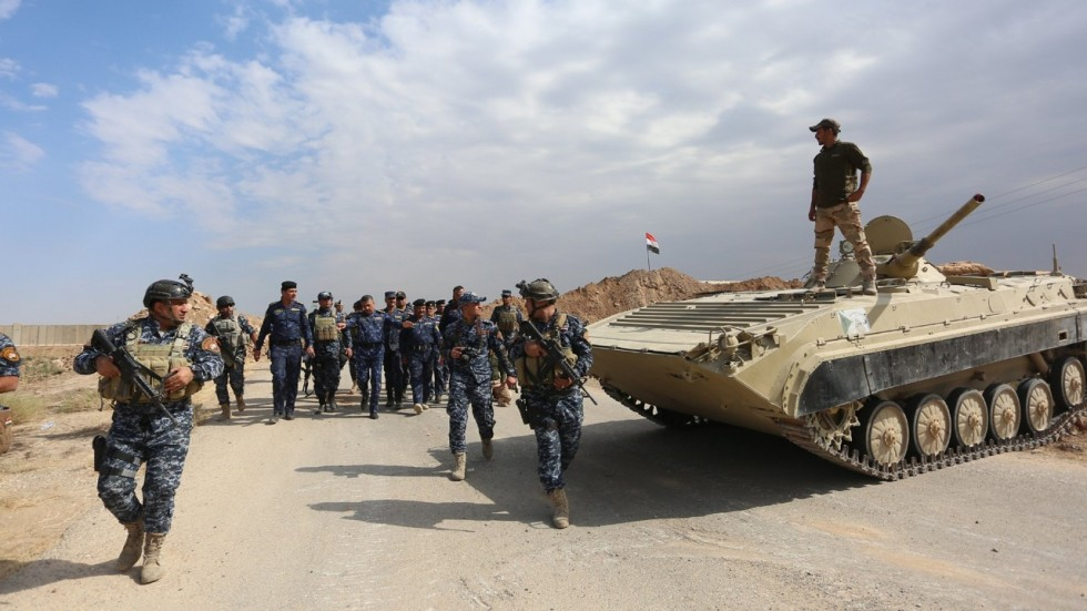 Iraqi security forces have amassed south of Kirkuk as tensions with Kurds heighten