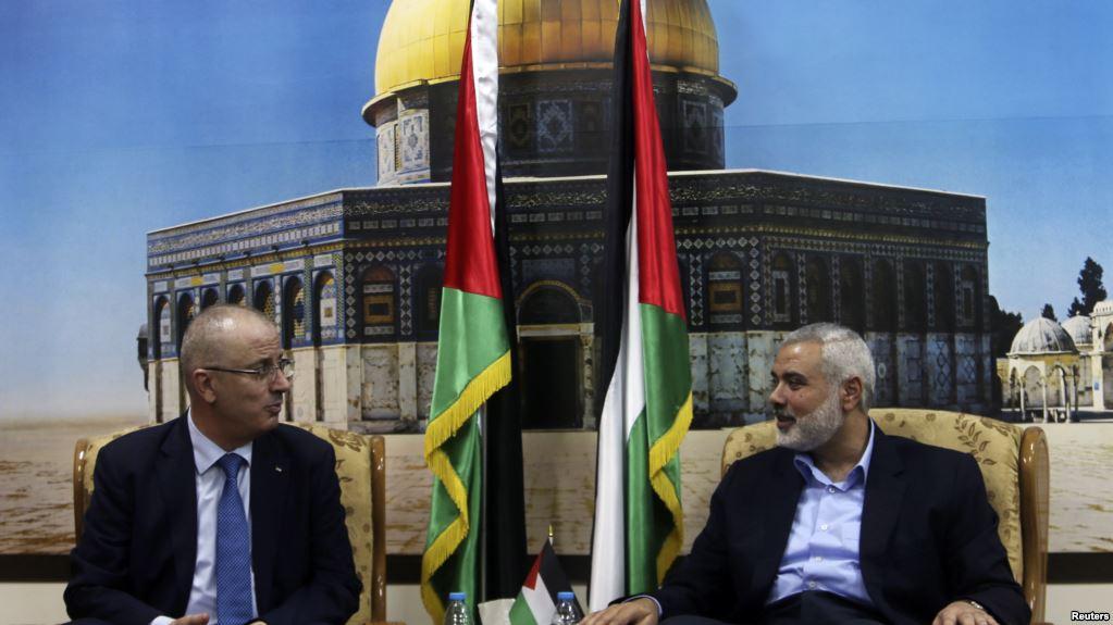 Palestinian prime minister Rami Hamdallah and senior Hamas official Ismail Haniyeh