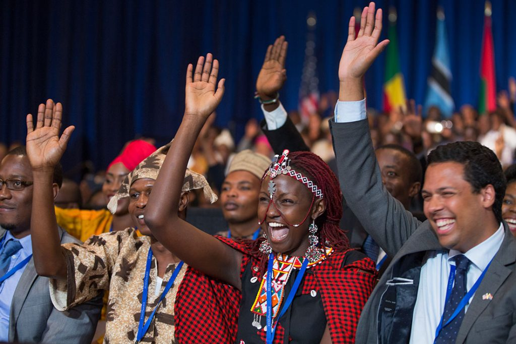 People taking part in the Young African Leaders Initiative town hall raise their hands as President Barack Obama delivers remarks a the summit in Washington, D.C., July 28, 2014.