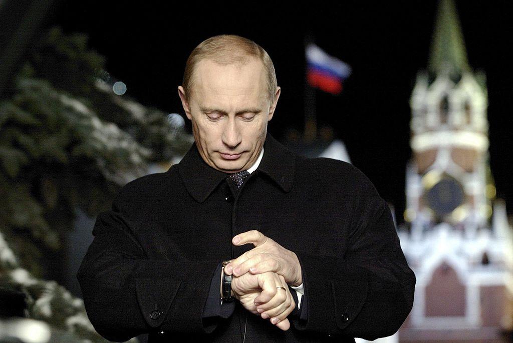 Russian President Vladimir Putin looks a