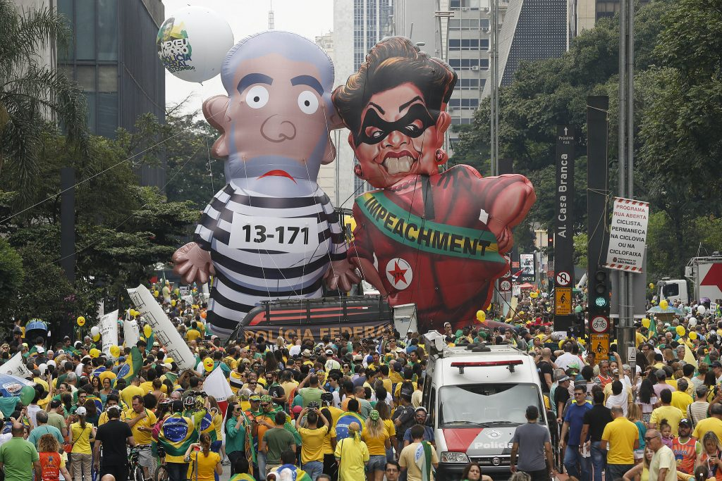 Brazilian demonstrators parade inflatable dolls depicting former President Luiz Inacio Lula da Silva as an inmate and (then) President Dilma Rousseff as a thief in Sao Paulo.