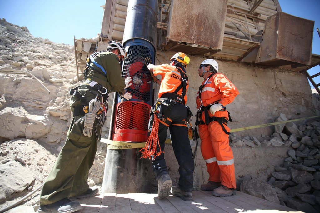 Rescue workers practice a dry run with one of the capsules that will be used to liberate the trapped miners at the San Jose mine near Copiapo, Chile on October 11, 2010.