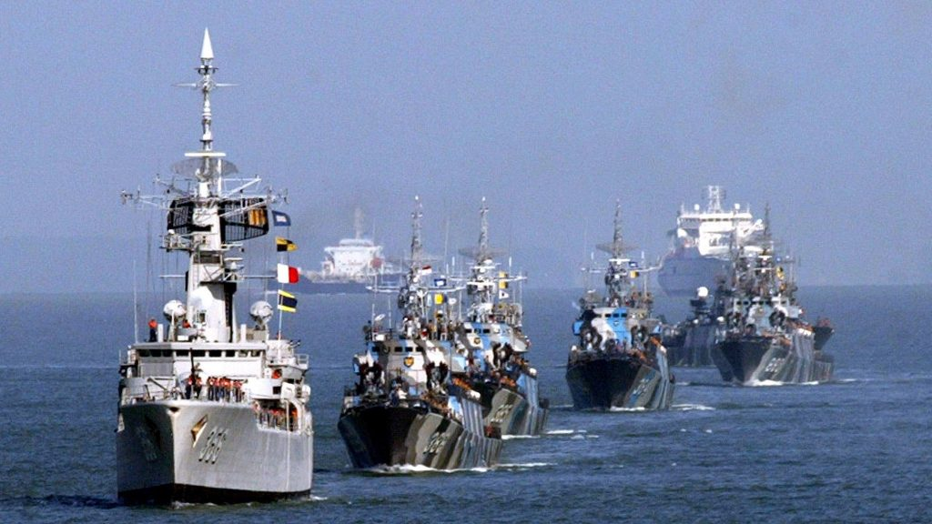 Naval ships from Indonesia, Singapore and Malaysia sail during a ceremony to launch a trilateral coordinated patrol between the three countries in the Strait of Malacca on July 20, 2004.
