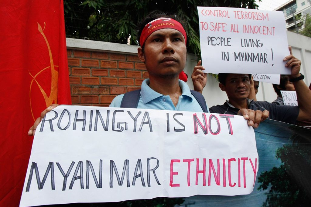 Buddhist citizens of Myanmar living in Thailand hold anti-Rohingya banners as they gather outside the Myanmar embassy in Bangkok