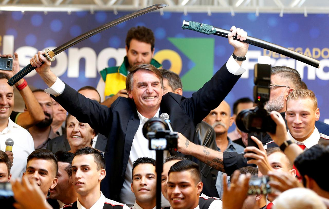 FILE PHOTO: Federal deputy Jair Bolsonaro, a pre-candidate for Brazil's presidential elections, shows a sword during a rally in Curitiba