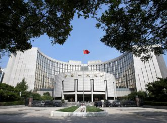 Chinese central bank cuts reserve requirements to cushion financial system